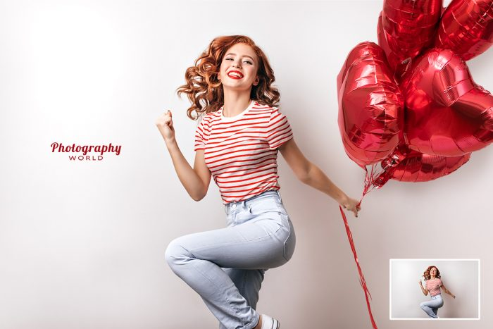 Girl Jumping With Heart Balloons